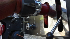 Water dripping from fire house at fire scene Stock Footage