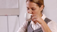 Stock Video Footage of Elegant businesswoman drinking hot beverage