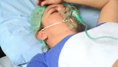 Female Patient with oxygen mask 3 Stock Footage