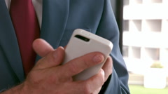 Elegant businessman using smartphone Stock Footage