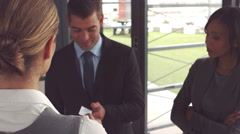 Businesswoman giving business card and handshake - stock footage