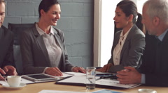 Business people handshake during meeting - stock footage