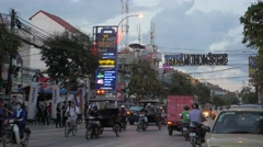 Busy road with neon signs in nightlife area,Siem Reap,Cambodia Stock Footage