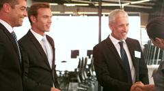 Business people having a handshake - stock footage