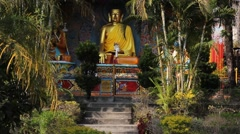 Statue of Buddha in a garden Stock Footage