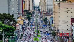 Stock Video Footage of Timelapse View of Rush Hour Traffic in Curitiba, Brazil - Zoom Out