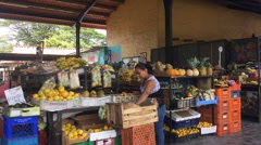 Time-lapse of woman working in Central American fruit market (HD) Stock Footage