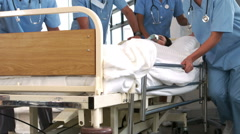 Team of doctor resuscitating a patient - stock footage