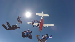 Skydiving group jumping from the plane - stock footage
