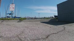 Los Angeles Harbor shipyard- Drone ftg take off Stock Footage