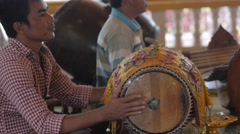 Man plays drum in temple,Siem Reap,Cambodia Stock Footage