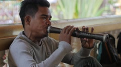Man plays srolai wind instrument in temple,Siem Reap,Cambodia Stock Footage