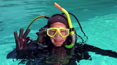 Woman in scuba diving doing ok sign Stock Footage
