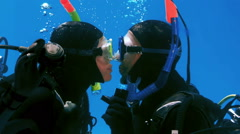 Couple in scubas diving kissing in the pool Stock Footage