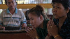 Ladies praying in temple while music is played,Siem Reap,Cambodia Stock Footage