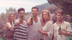 Happy friends holding beer bottles - stock footage