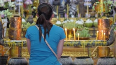 Back of young lady praying at shrine in temple,Siem Reap,Cambodia Stock Footage