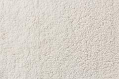 White synthetic fleece texture background - stock photo