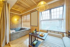 Interior of modern bedroom with bathtub Stock Photos