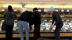 People buying food inside superstore Stock Footage