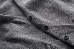 Wool cardigan sweater in grey close up Stock Photos