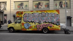 Colorful graffiti truck with RFC piece in spray paint panning to Union Square NY Stock Footage