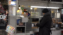 Food cart on Union Square outside Reebok store on cold fall winter day, pretzels Stock Footage