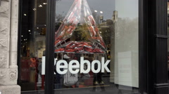 Reebok store sign in glass window display on Union Square in NYC 1080 HD - stock footage