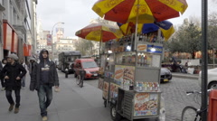 Union Square hot dog vendor - umbrella cart selling street food on cold day NYC Stock Footage