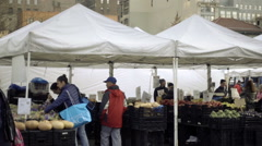 Wide shot of Union Square farmers market with truck delivering fresh organic NYC Stock Footage
