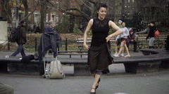 Bellydancing Middle-Eastern woman with drummer in Washington Square Park, NYC Stock Footage