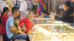 Family buying bracelet in jewelry stall in market ,Siem Reap,Cambodia Stock Footage