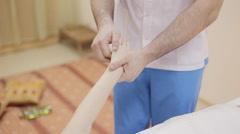 Massage therapist making massage of hand Stock Footage