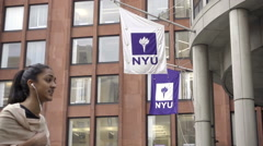 NYU Stern School of Business building, Indian girl walking by, student in NYC Stock Footage