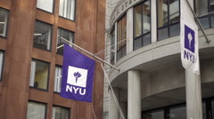 NYU flags panning to Stern School of Business building with students entering NY Stock Footage