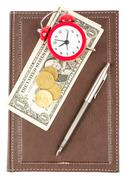 Leather daily planner with cash and alarm clock - stock photo