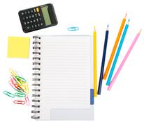 Open notebook with stationery and calculator - stock photo