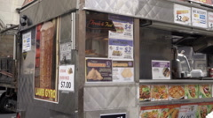 Panning across Halal food truck with NYU students stop sign Greenwich Village NY Stock Footage