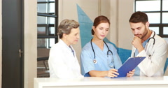 Medical team looking at documents Stock Footage