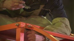 Man strong work hands tighten with a wrench bolt Stock Footage