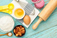 Baking cupcake with ingredients flour eggs almond nuts and rolling pin from a Stock Photos