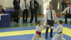 Young people compete in karate Stock Footage