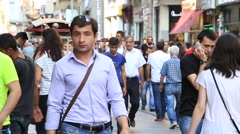 People walk through one of the busiest shopping streets in Istanbul, Turkey Stock Footage