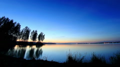 Sunset, night and sunrise over Beloyarsk reservoir. Beloyarsk, Sverdlovsk region - stock footage