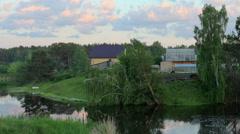 Sunset on the river Ushakovka. Ushakova village, Tyumen region, Russia, Full HD Stock Footage