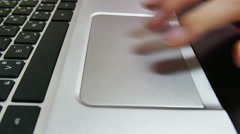 4k close-up Moves Finger on the Trackpad. - stock footage
