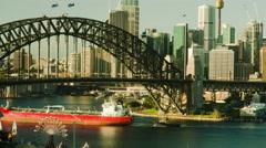 4K Cargo ship passes under Sydney Harbour Bridge static Stock Footage