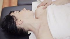 Massage therapist making massage of neck Stock Footage