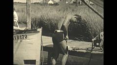Vintage 16mm film, 1935, people, repair damaged boat Stock Footage