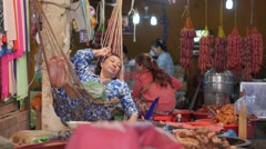 Woman relaxing in hammoch while waiting for customers,Siem Reap,Cambodia Stock Footage